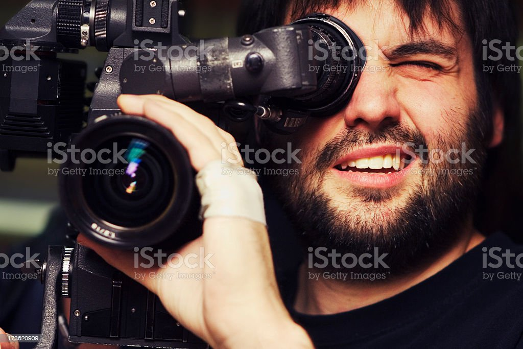 Close-up of videographer filming with bandage on hand stock photo