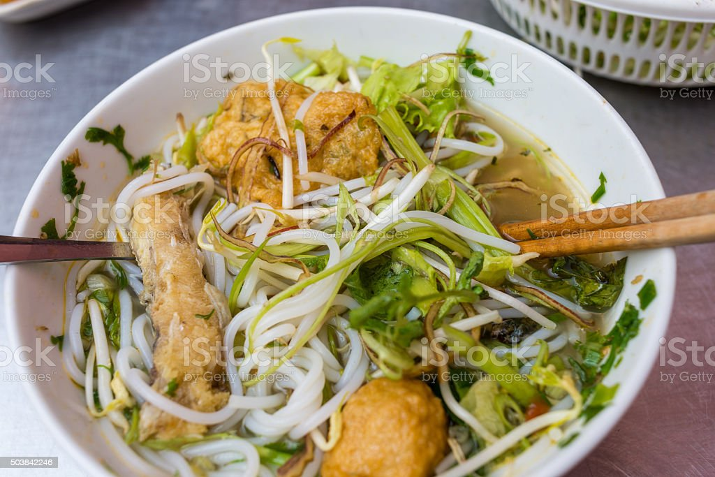 Close-up of Vietnamese traditional noodles soup with meatball and vegetable stock photo