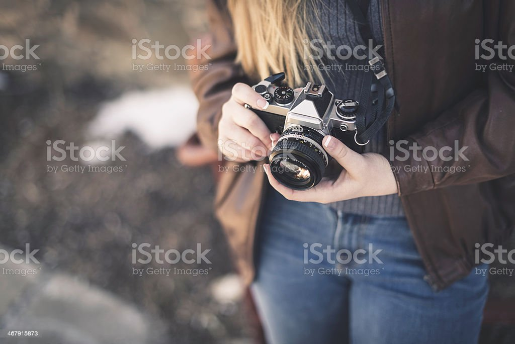 Close-up of Vintage Film Camera Held by a Woman stock photo