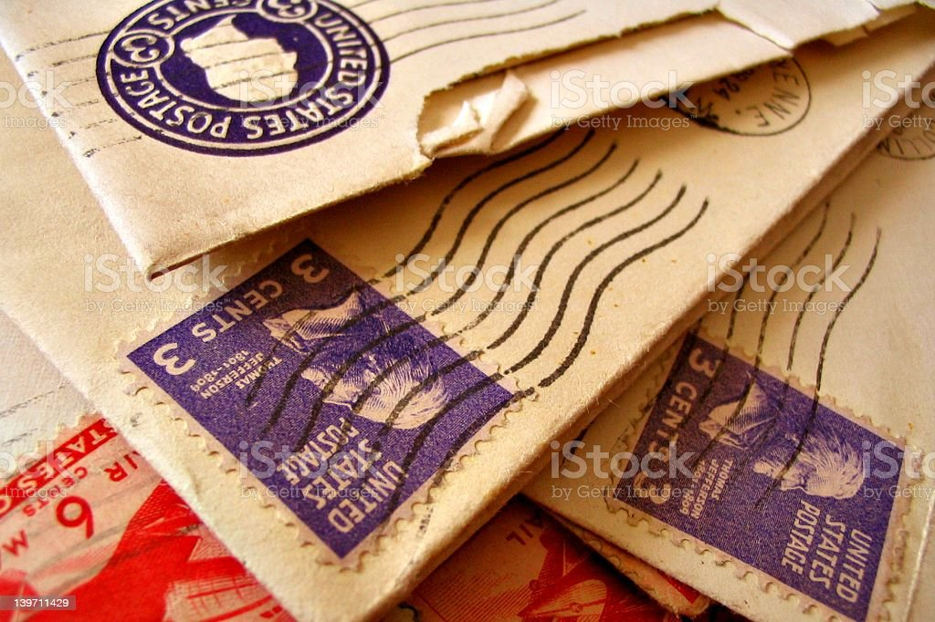 A close-up of vintage postage on envelopes stock photo