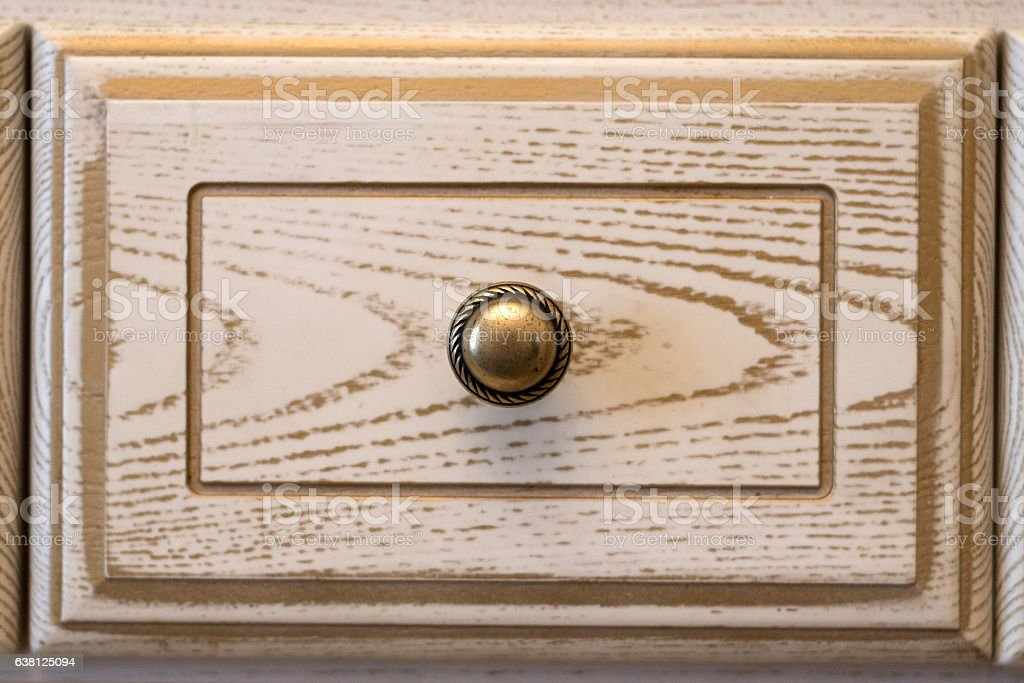 Closeup of vintage wooden kitchen cupboard stock photo