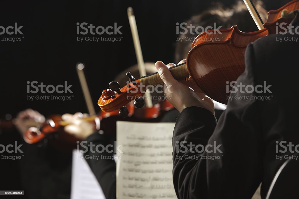 Close-up of violinists in concert stock photo