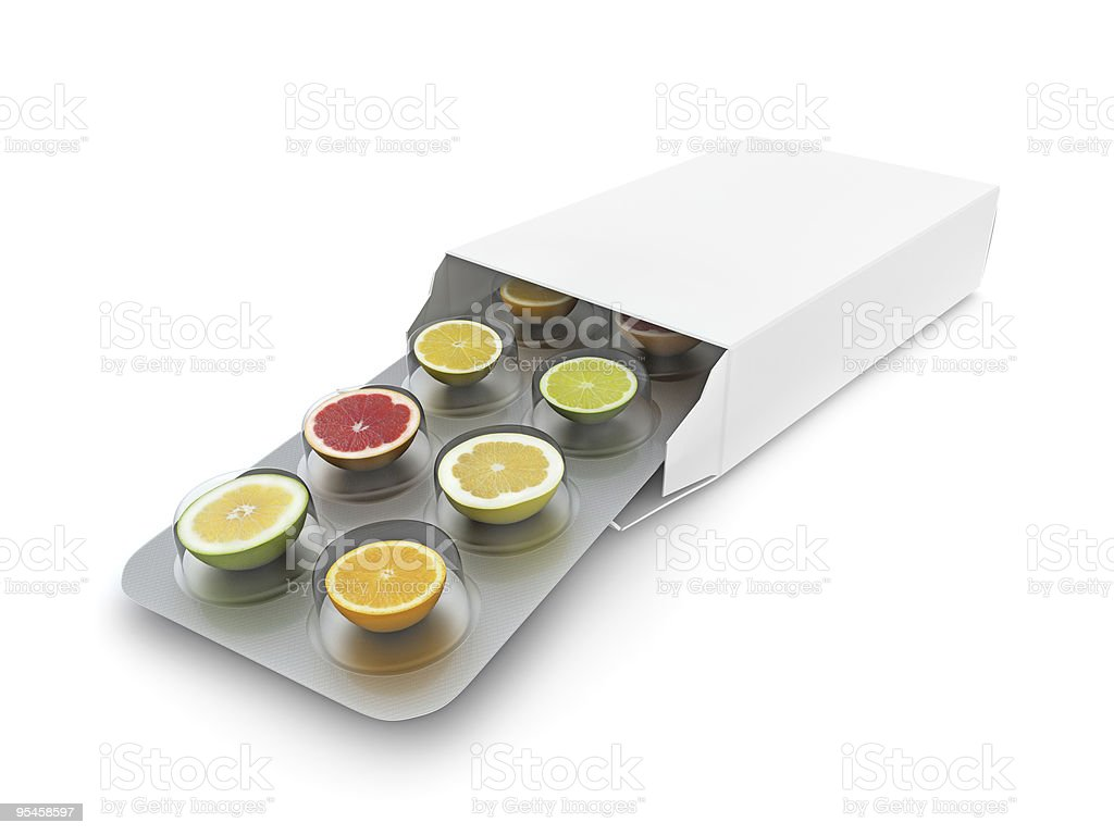 Closeup of vitamin pills showcasing different fruits royalty-free stock photo