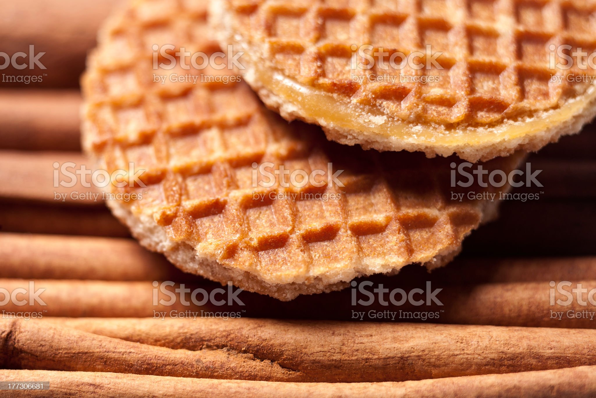 Close-up of waffle cookies on top of cinnamon sticks royalty-free stock photo