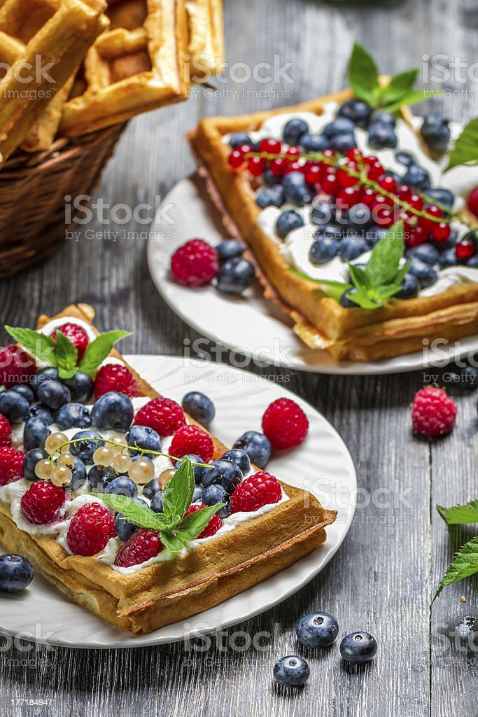 Closeup of waffles with fresh berry fruit royalty-free stock photo