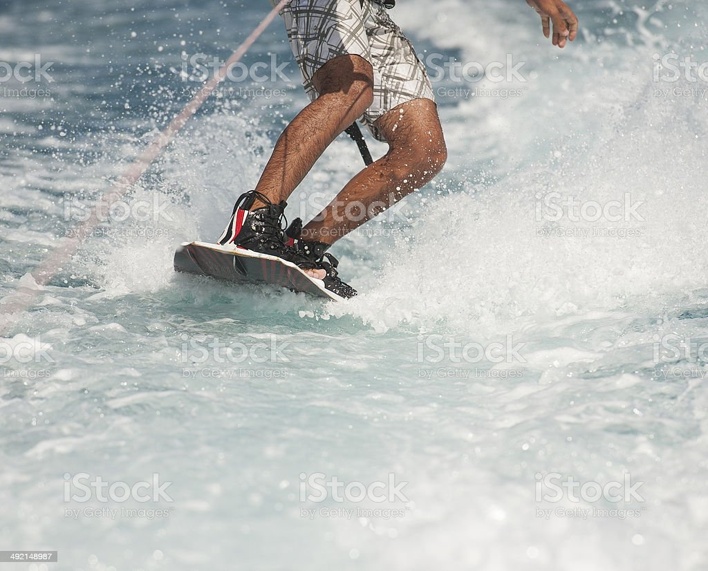 Closeup of wakeboarder on water stock photo
