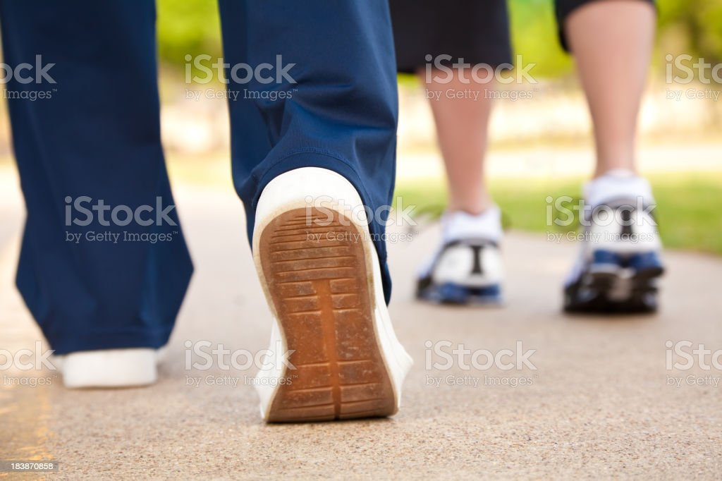 Closeup of Walker's Shoes on a Pathway stock photo