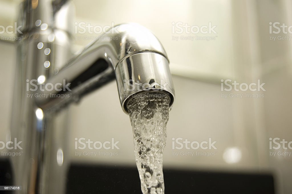 Close-up of water coming from the tab royalty-free stock photo
