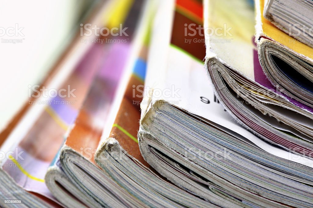 A close-up of weathered magazines stock photo