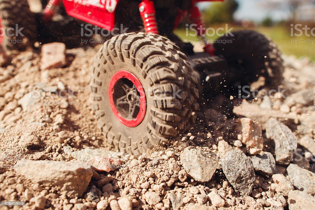 Close-up of wheel slipping in rock trace stock photo