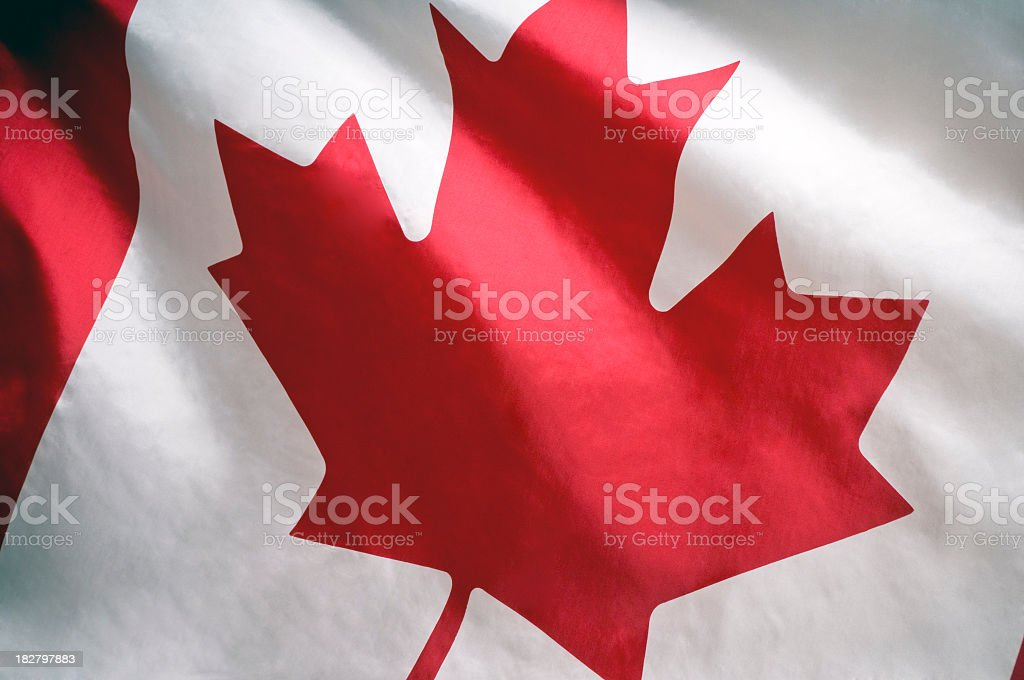 Closeup of white and red Canadian flag royalty-free stock photo