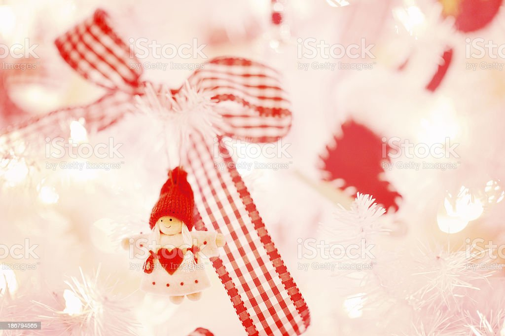 Closeup of White Christmas Tree With Red Decorations and Ribbon royalty-free stock photo
