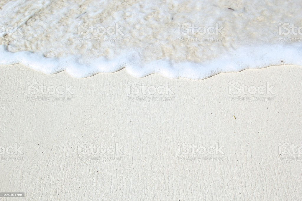Close-up of white coastline beach with waves stock photo