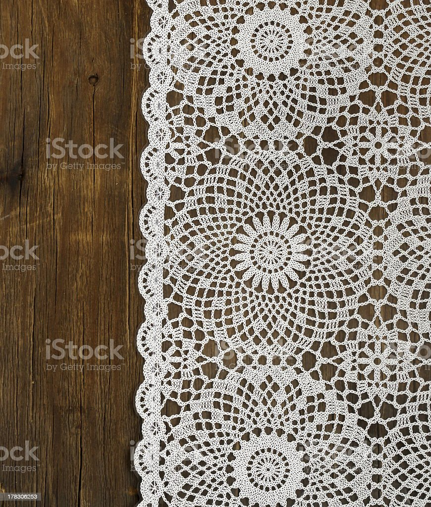 Close-up of white lace napkin on wooden table stock photo
