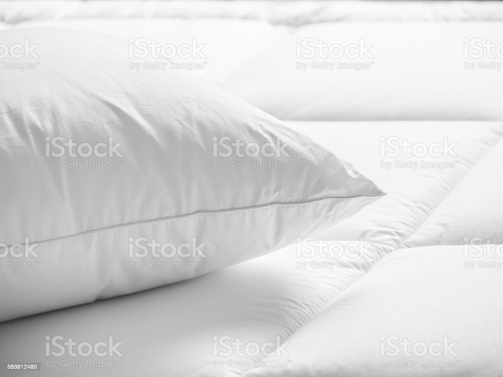 Closeup of white pillow on the bed in the bedroom stock photo