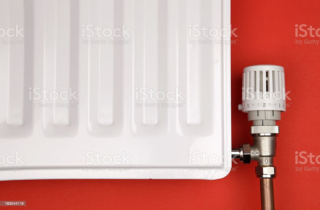 Closeup of white radiator and thermostatic valve royalty-free stock photo