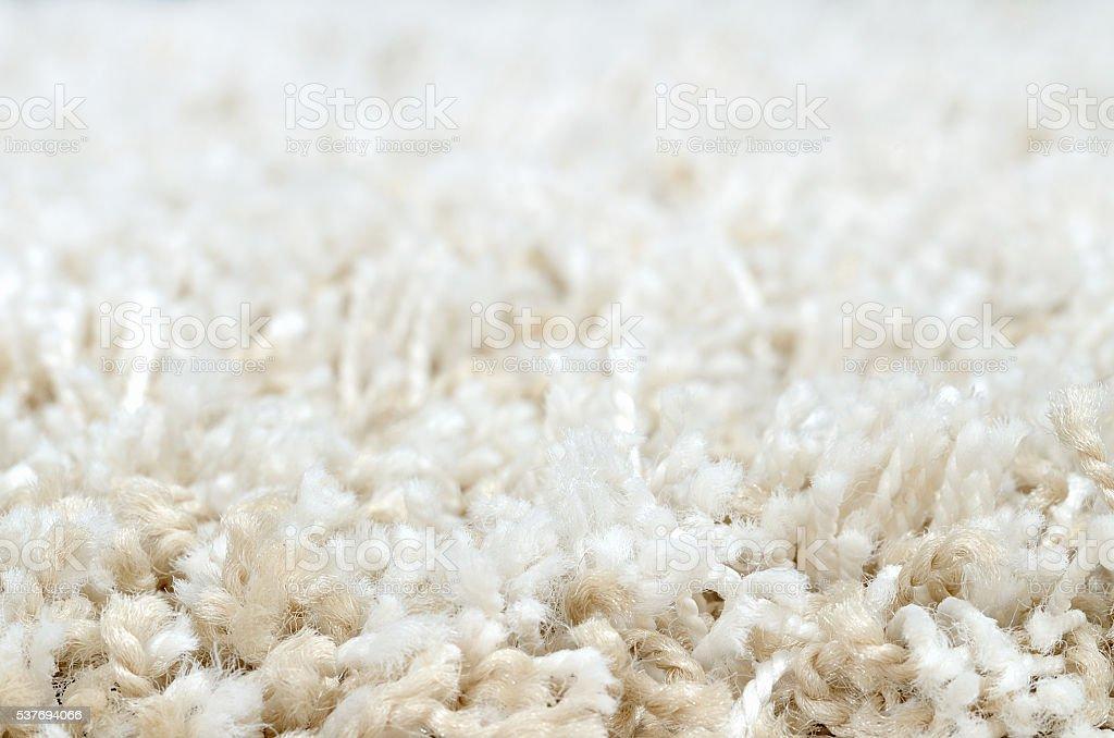 Close-up of white shaggy carpet stock photo