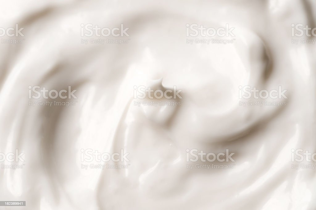 Close-up of white smooth rich facial cream stock photo