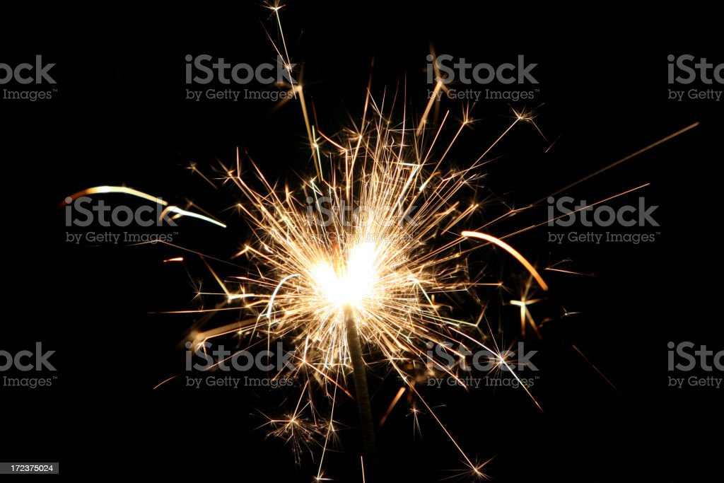 Close-up of white sparkler against black background royalty-free stock photo