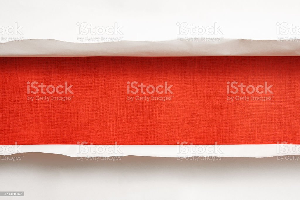 Close-up of white torn paper on orange background royalty-free stock photo
