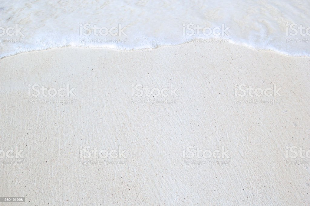 Close-up of white tropical beach with waves stock photo