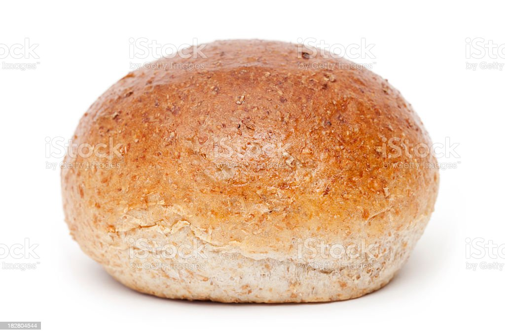 Close-up of whole meal bread on white background stock photo