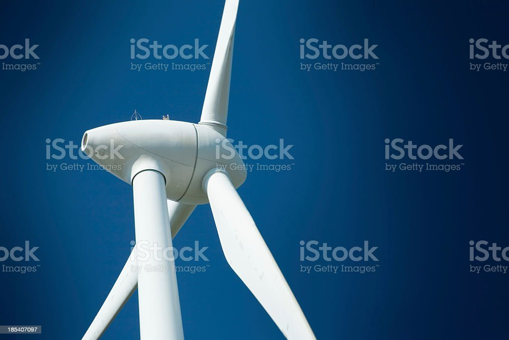 Close-up of wind turbine against blue sky stock photo