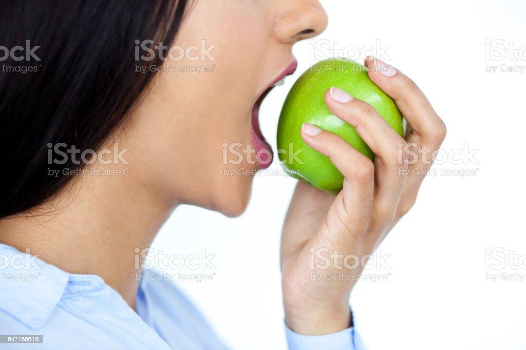 Close-up of woman biting apple stock photo