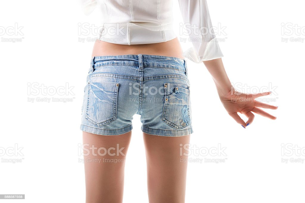 Close-up of woman buttocks in jeans shorts. stock photo
