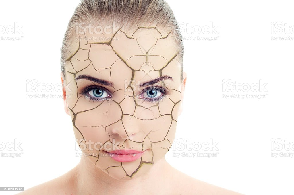 Close-up of woman cracked and damaged face stock photo