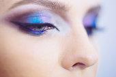 Closeup of woman eyes with beautiful fashion bright makeup