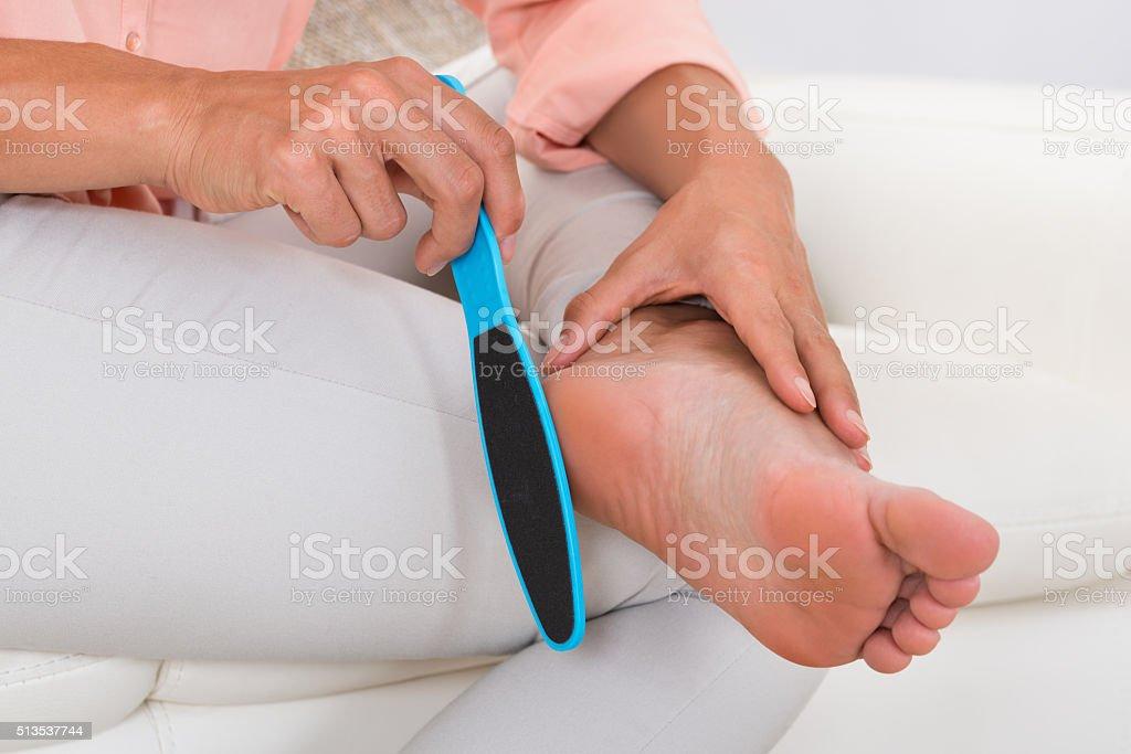 Close-up Of Woman Filing Foot stock photo