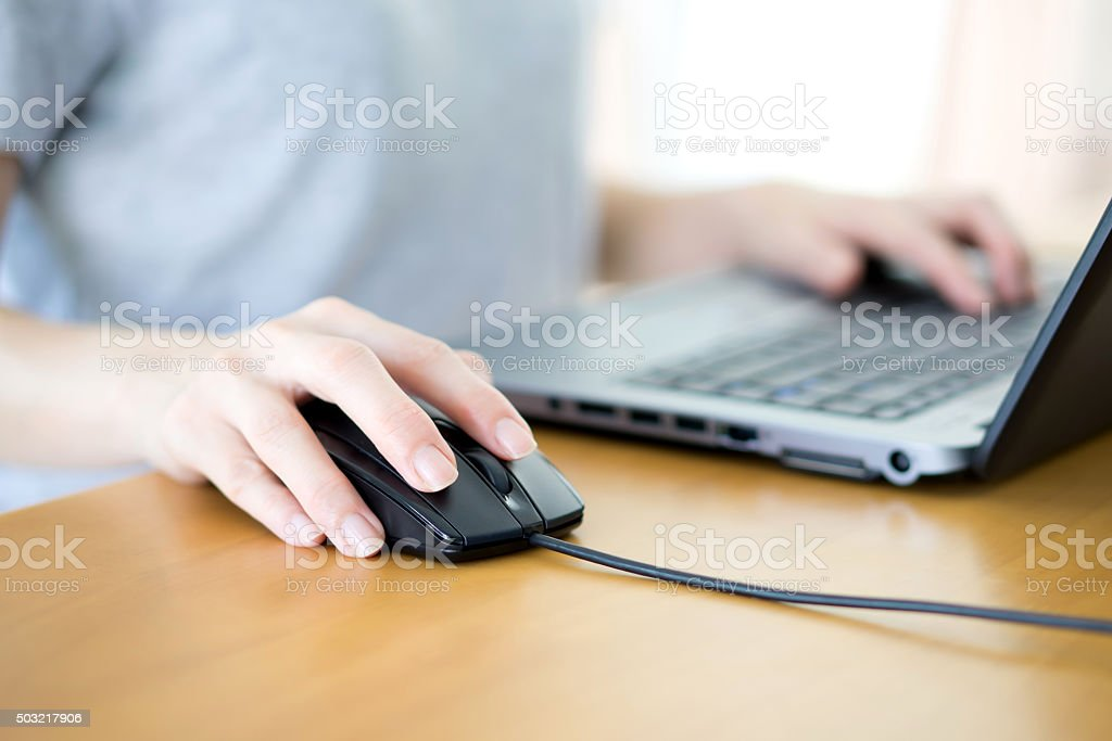Closeup of woman hand clicking mouse outdoor stock photo