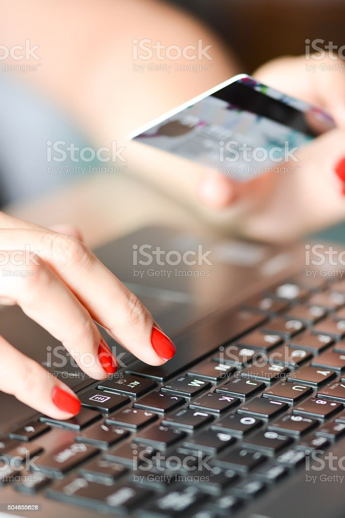 Close-up of Woman hand holding credit card for online shopping stock photo