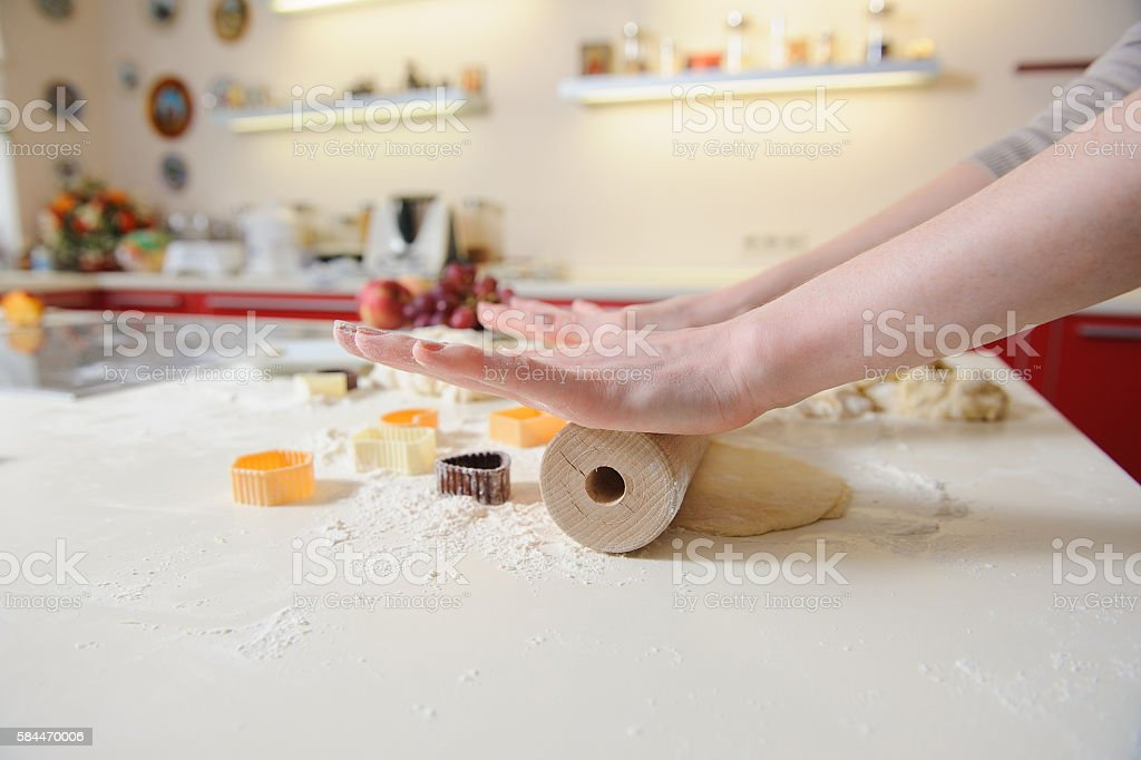 Closeup of woman hand with rolling baking cookies stock photo
