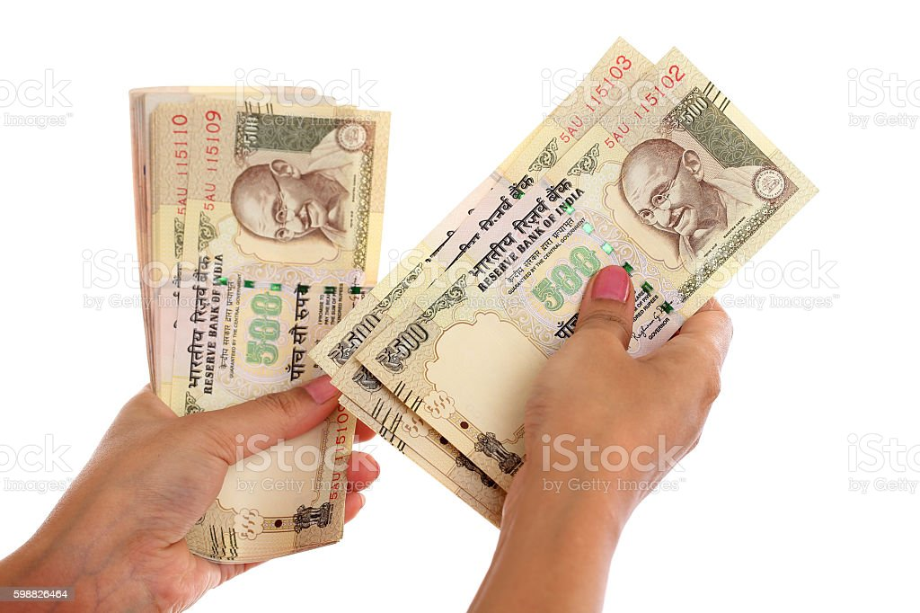 Closeup of woman hands counting money against white background stock photo