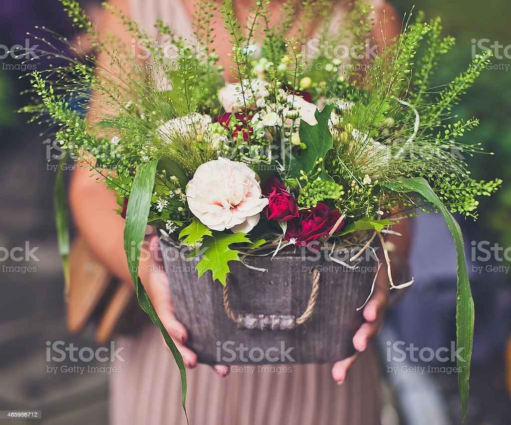 Close-up of woman hands keeping flowers basket stock photo