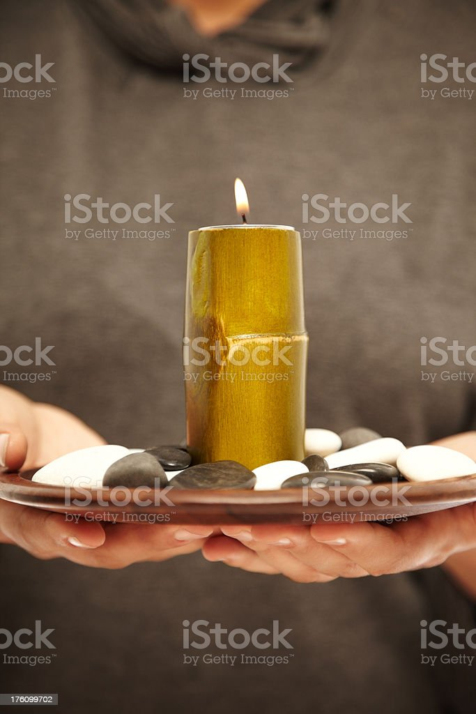 Close-up of Woman Holding Candle royalty-free stock photo