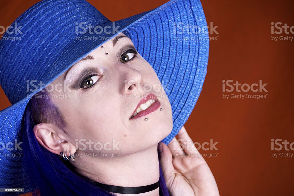 Closeup of woman holding down hat edge. royalty-free stock photo