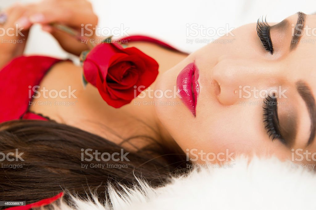 Close-up of woman holding rose royalty-free stock photo