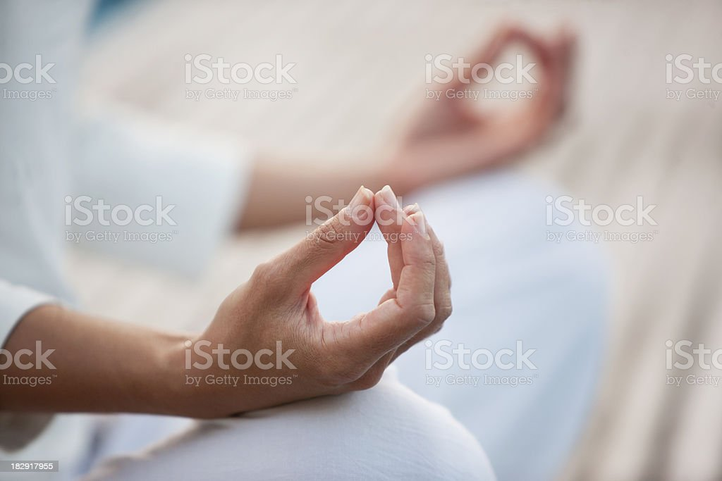 Closeup of woman in yoga posture stock photo