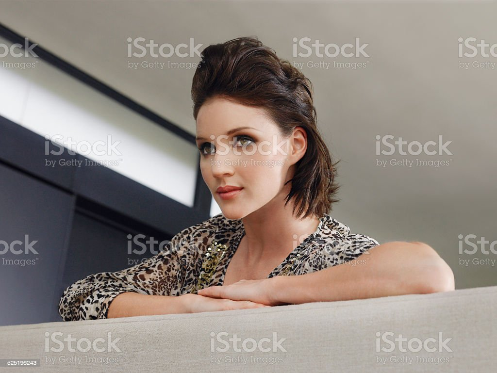 Closeup Of Woman Leaning On Couch stock photo