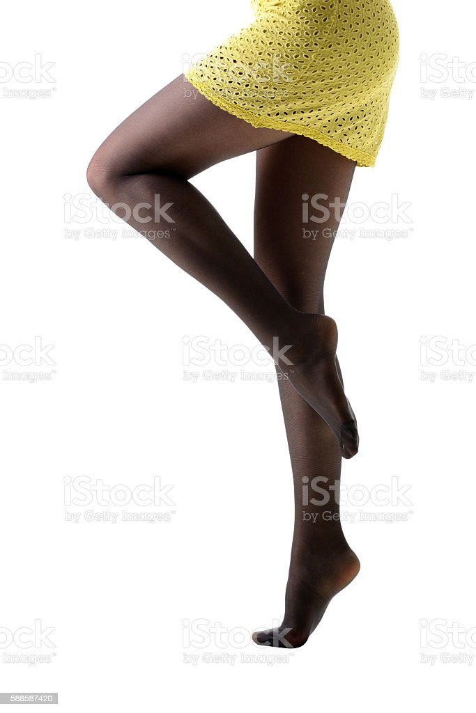 Close-up of woman legs in black stockings stock photo