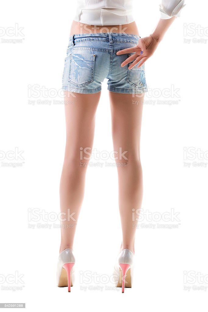 Close-up of woman legs in jeans shorts. stock photo