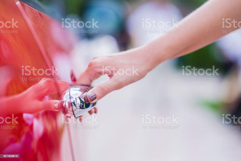 Close-up of woman opening a car door stock photo