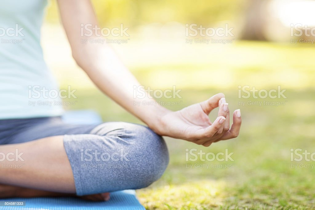 Close-up Of Woman Practicing Yoga In Lotus Position stock photo