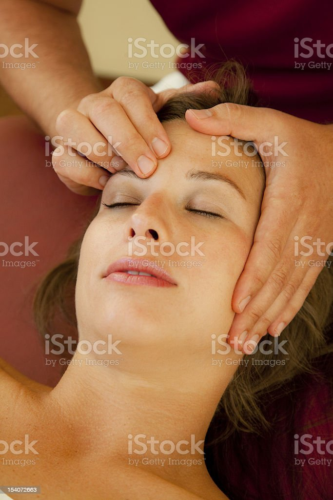 Close-up of woman receiving pressure point massage royalty-free stock photo