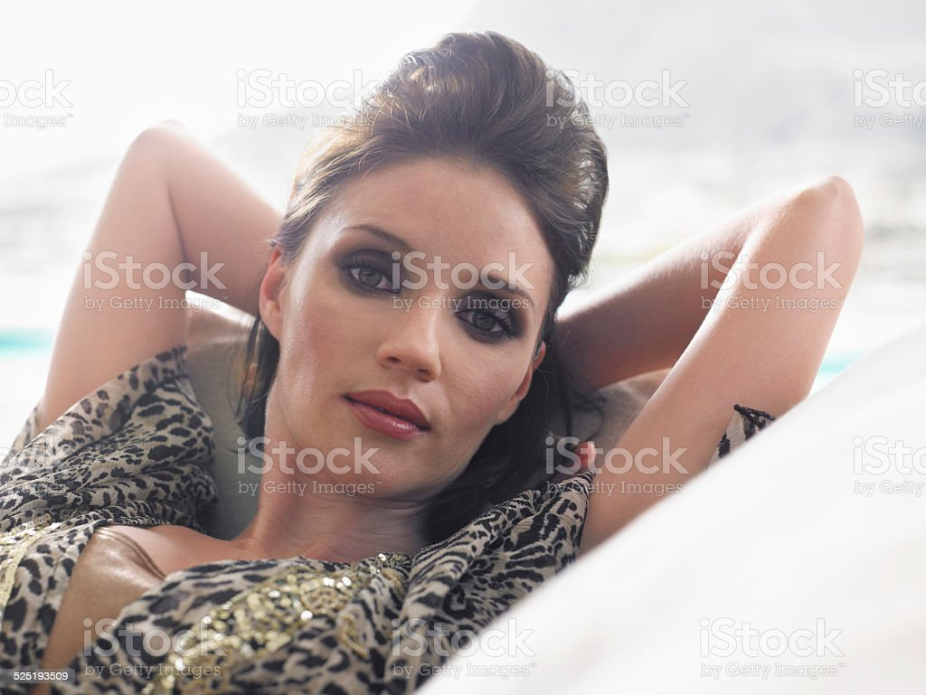 Closeup Of Woman Resting On Couch stock photo