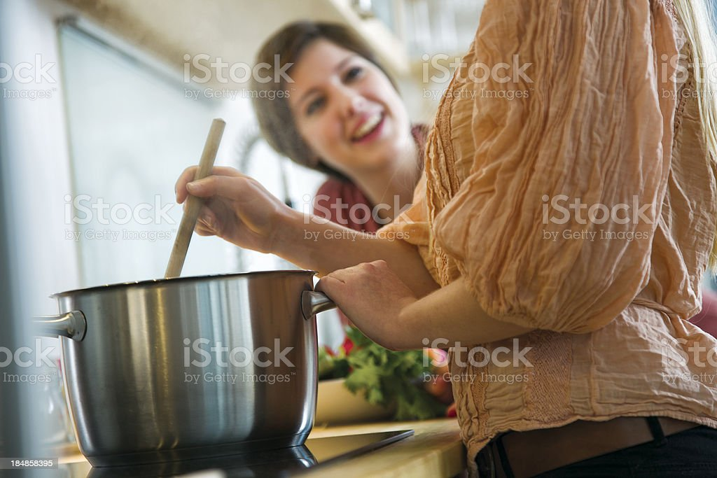 Close-up of Woman Stiring cooking Pot stock photo
