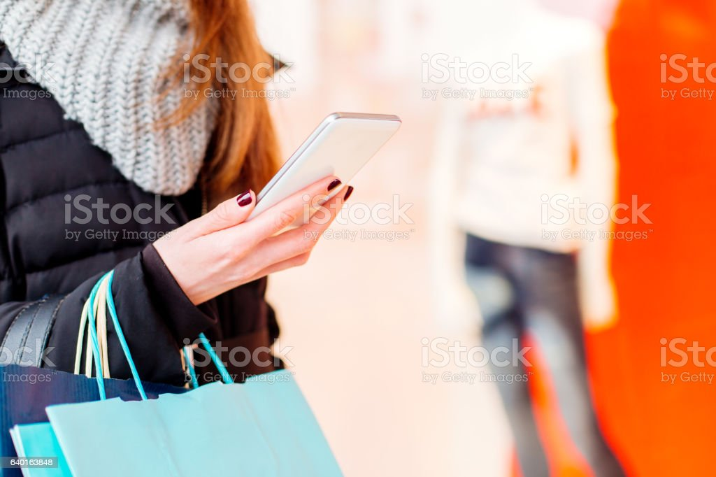 Closeup of woman using her smartphone stock photo